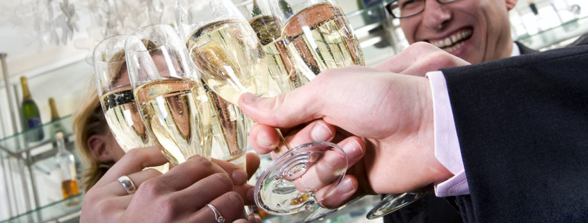 several people toasting with champagne on new years eve